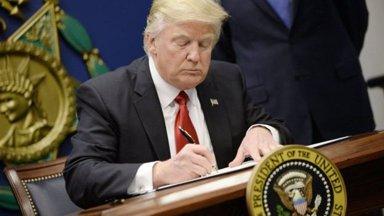 trump_signing_small.jpg